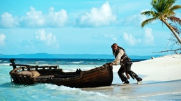"Jack Sparrow wallpaper pushes the boat into the sea from the movie ""Pirates of the Caribbean"" movie"