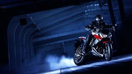 Wallpaper Motorcyclist in a hangar at Kawasaki smoke