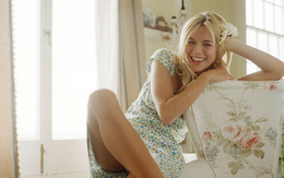 Sienna Miller wallpapers with flower in her hair laughing, sitting on a chair ethnic movies