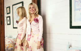 Wallpaper Sienna Miller in a pink blouse with flower stands near the mirror and smiling movie